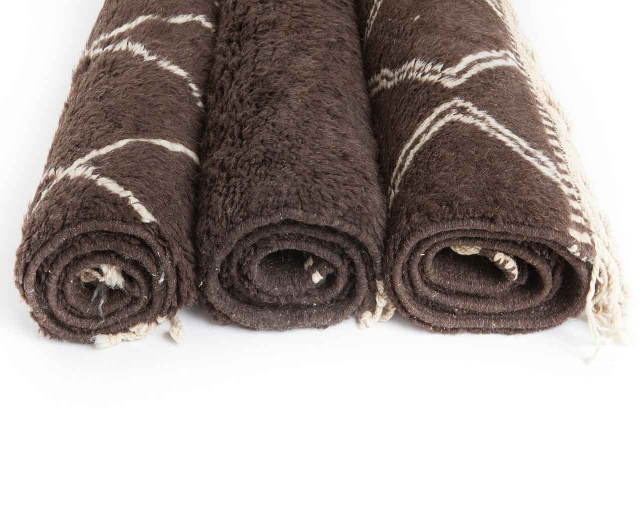 brown beni ourain carpets rolled up 1