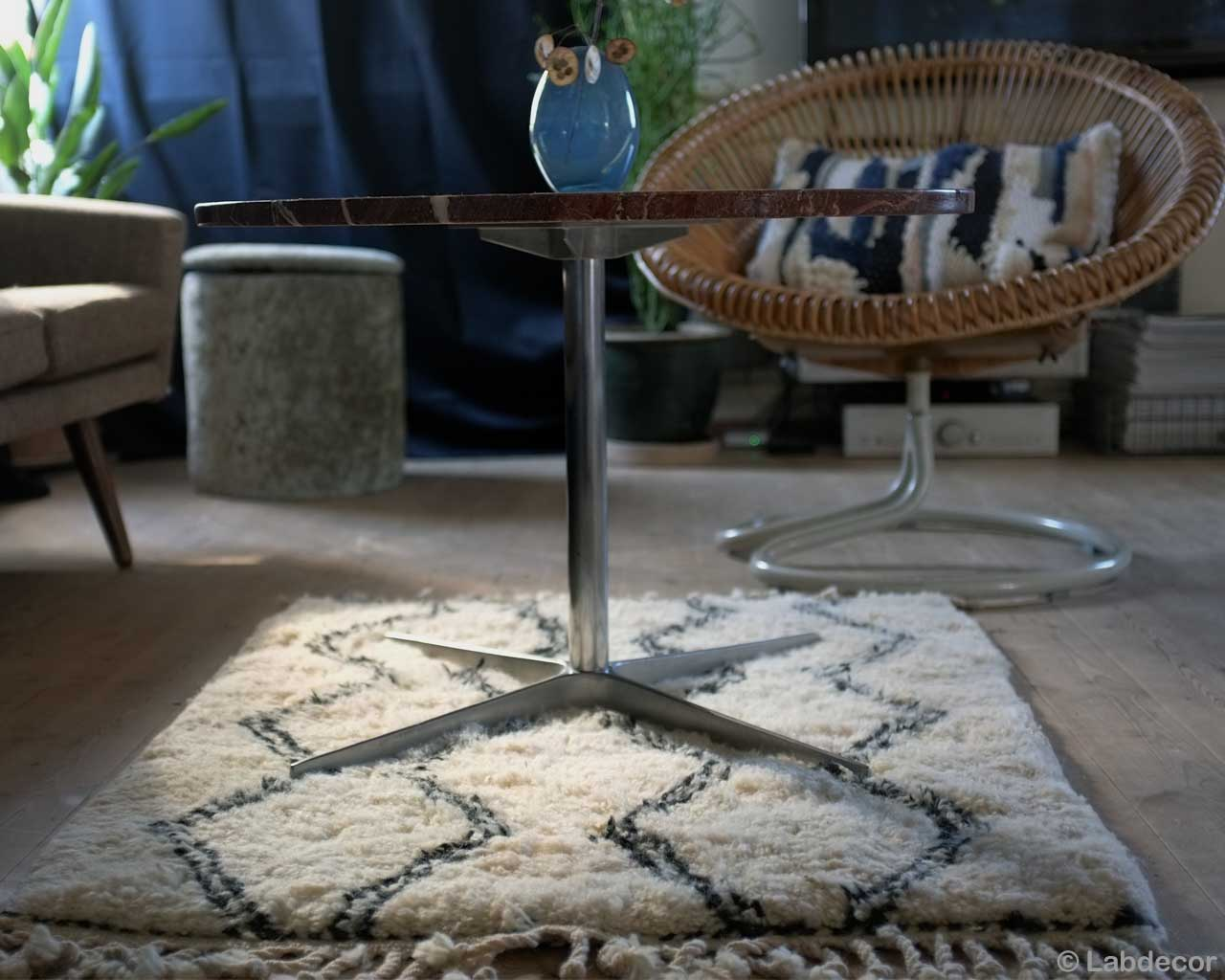 chair and blue vase on round table from morocco rugs