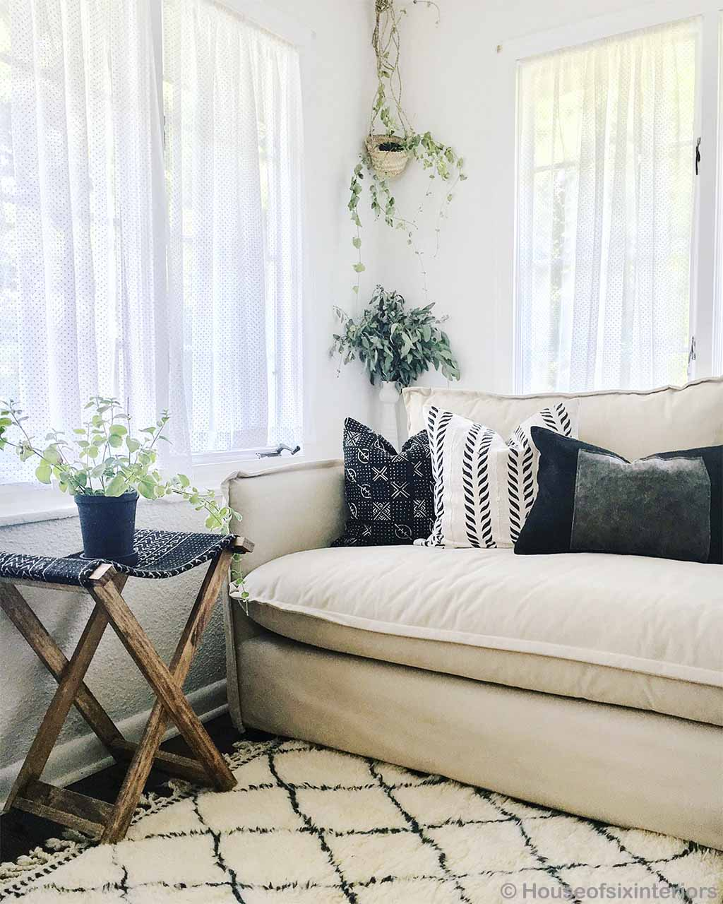 cream sofa with multiple cushions made in morocco kitchen rugs