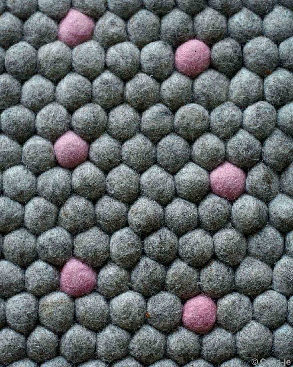 nepal dark gray felt ball with pink pattern small rug