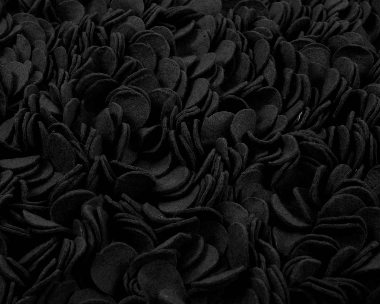 black felted wool rug close up design